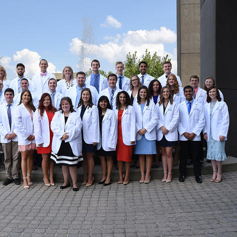 35 students in white coats