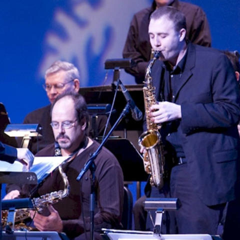 photo of BAJA saxophone player performing at holiday concert