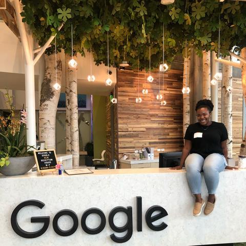 Kymberley Johnson poses by a Google logo