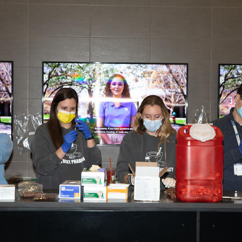 Pharmacy students and staff prepare the Covid Vaccine at Kroger Field on Jan. 22, 2021. Photo by Mark Cornelison   UK Photo.