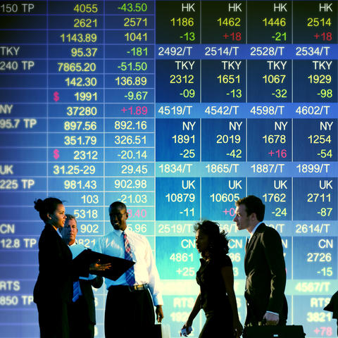 stock photo of business people and stock listings