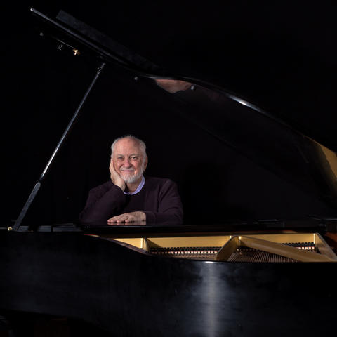 photo of Wayland Rogers seated at grand piano by Jerry Alt