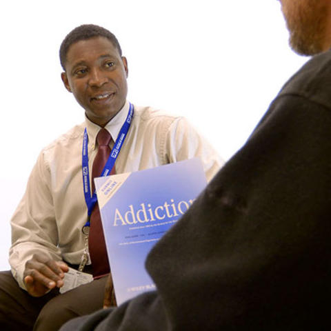 Okoli treats patients with addiction at Eastern State Hospital.