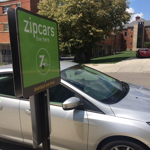 A Zipcar in its designated parking spot on Martin Luther King Boulevard