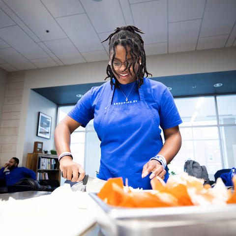 Student participates in Food Connection demonstration