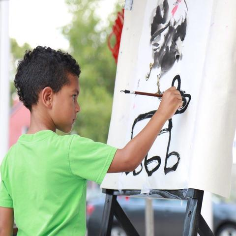 photo of child painting at Global Confucius Institute Day