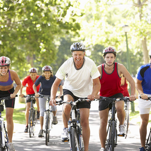 A group of people riding bikes.