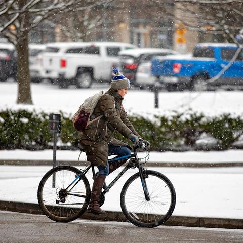 Women riding a bike.