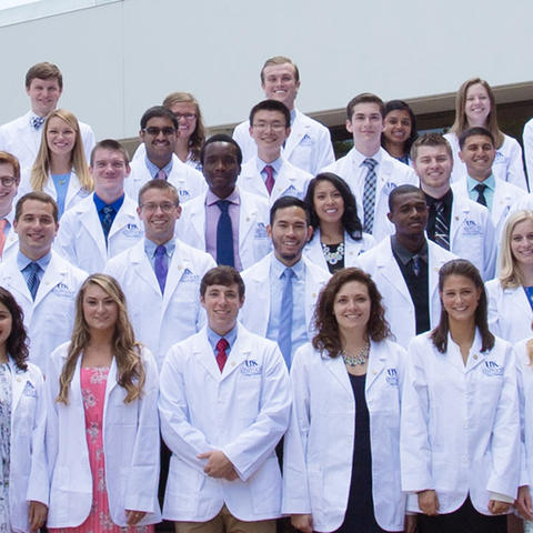 Group of medical students in white coats
