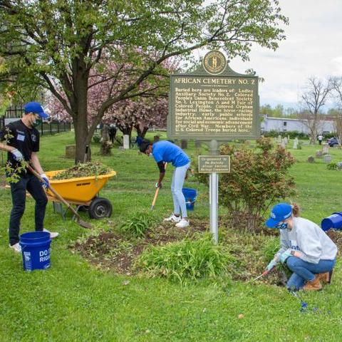 Volunteers at the Spring into Service event spruce up the landscaping at African Cemetery No. 2 in Lexington. Photo by Steve Patton, UK agricultural communications.