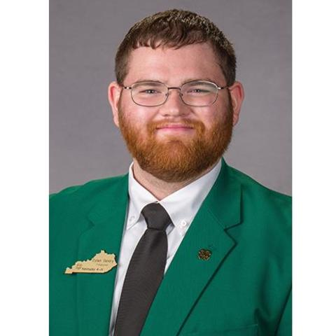 Headshot of UK senior Dylan Gentry pictured in green jacket with black tie