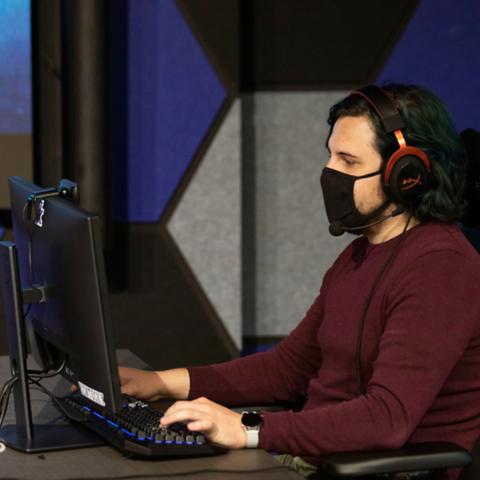 Man working on computer.