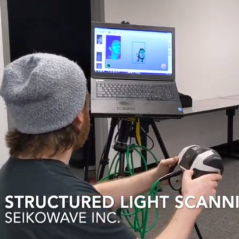 photo of Daniel Lau having his face scanned for a mask at Seikowave