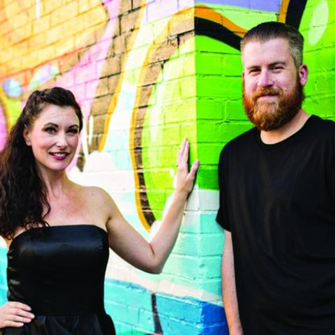photo of Jessica and John Winters by PRHBTN mural