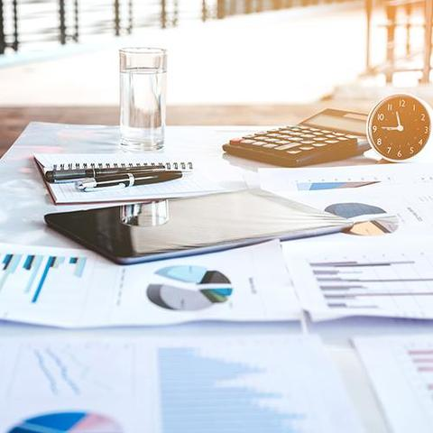 Stock image of financial tools on table