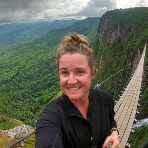 Sarah Marshall smiles on bridge overlooking landscape