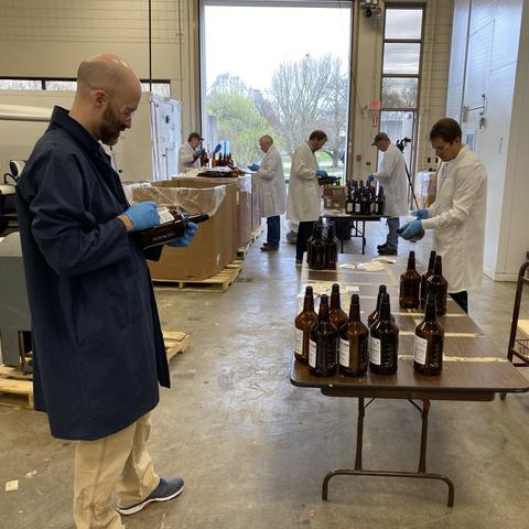 Brad Berron, left, and Seth DeBolt, right, in lab