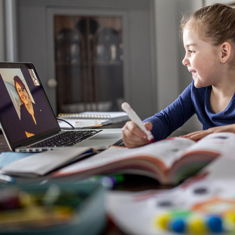 Young girl working with a virtual tutor.
