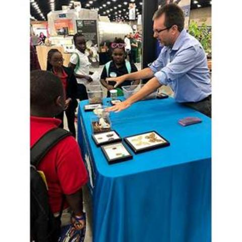 Blake Newton, UK entomology 4-H/youth extension specialist, shows fairgoers some of UK entomology's insect zoo during the 2018 Kentucky State Fair.