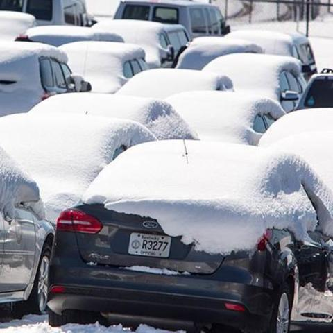 Cars in the UK motor pool covered in snow