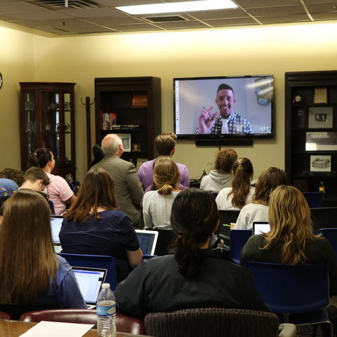 Photo of Beau Loendorf Skyping UK ISC students