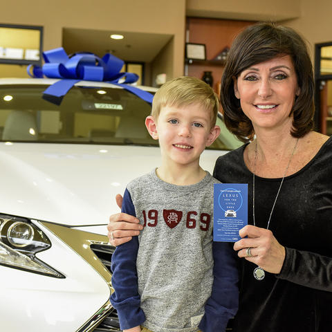 Brady Creemens with Lexus winner Eileen Potter.