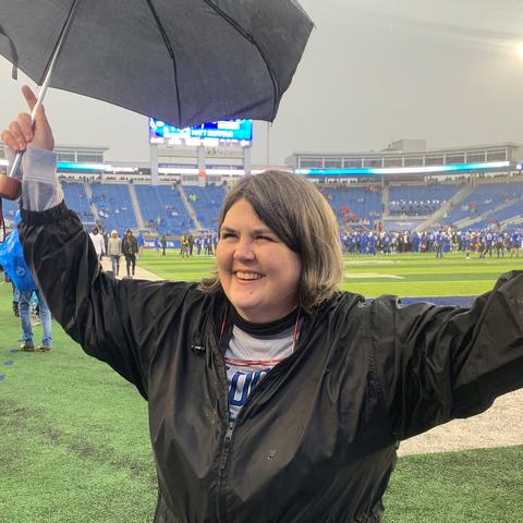 Photo of UK alum Ouita Michel during recognition at Kroger Field