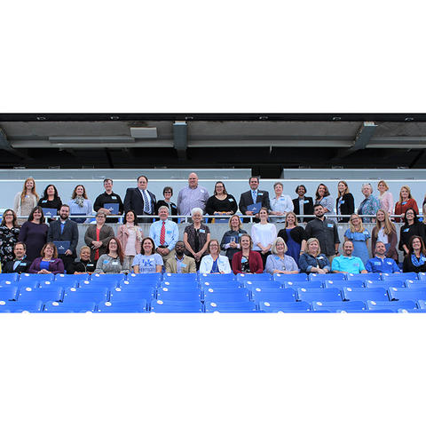 photo of award winners in stands at Kroger Field