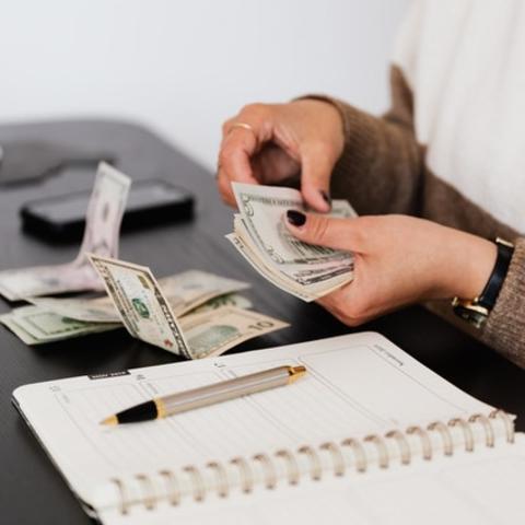 Woman handling cash.