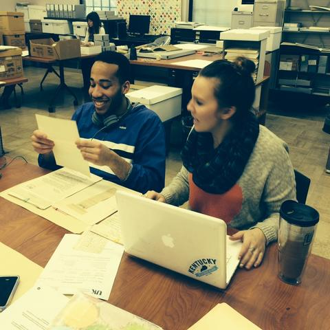 photo of 2 interns working in Special Collections Learning Lab