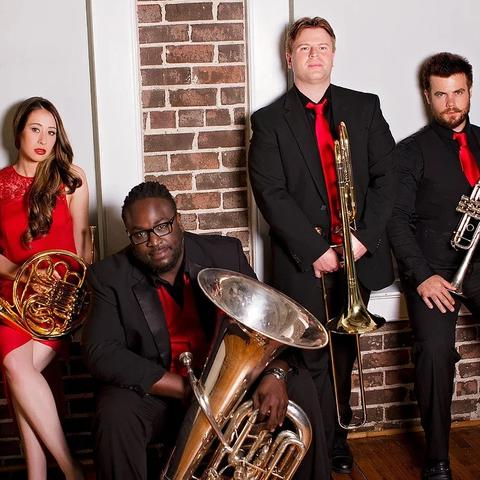 photo Alias Brass dressed in red and black holding instruments